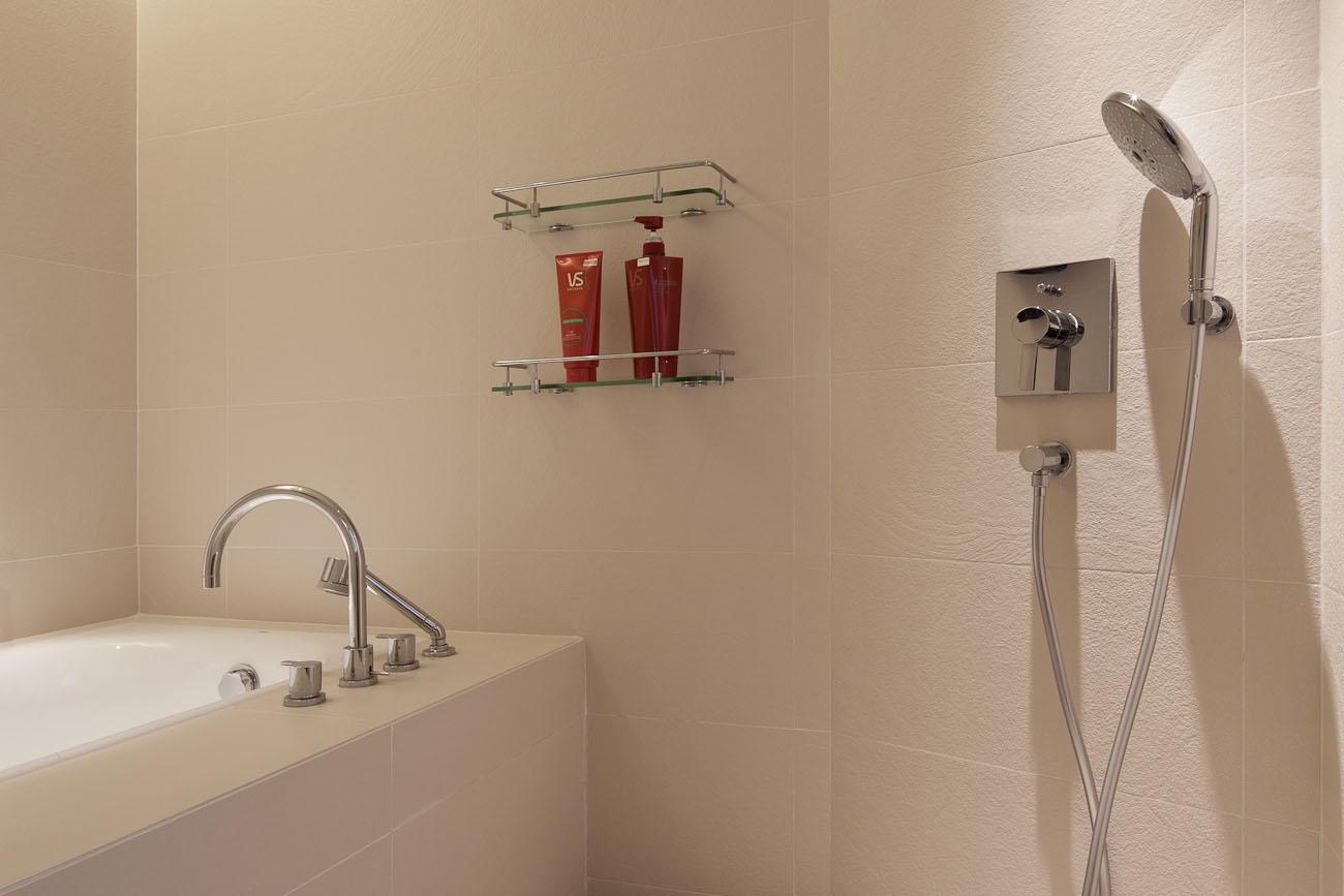 lui design associates designer interior apartment condo residential earth tones wood minimal hong kong china architecture sauna shower washroom bathroom